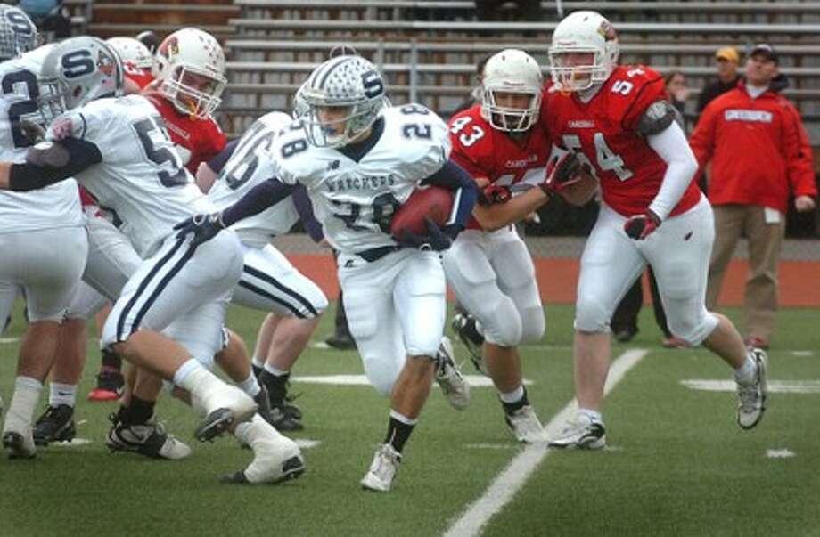 Photo/Alex von Kleydorff. Staples # 28 John Heil heads to the end zone for a touchdown vs Greenwich.