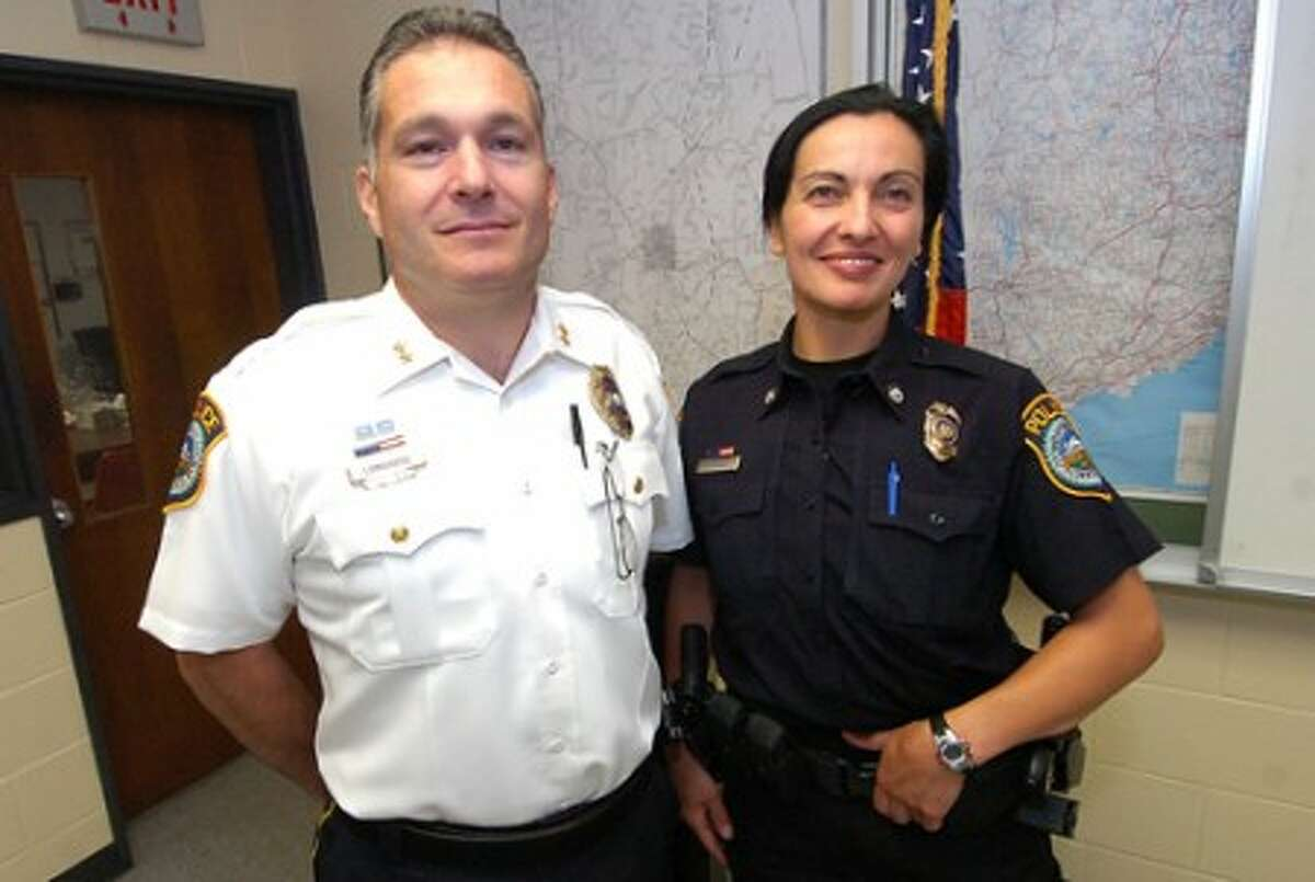 Photo/Alex von Kleydorff. Wilton Police Chief Michael lombardo and Wilton Officer Anna Tornello who graduated from the Police Academy at the top of her class.