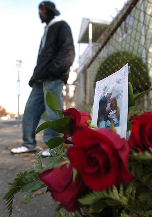 """Friends Michael """"Mizzy"""" Robinson, gather at a memorial to him the morning after he was gunned down at South Main and Grove streets in South Norwalk. Hour photo / Erik Trautmann"""