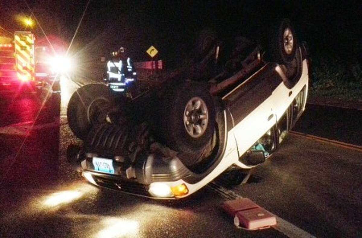 Contributed photo Westport emergency personnel respond to a rollover on Wilton Road early Sunday morning.