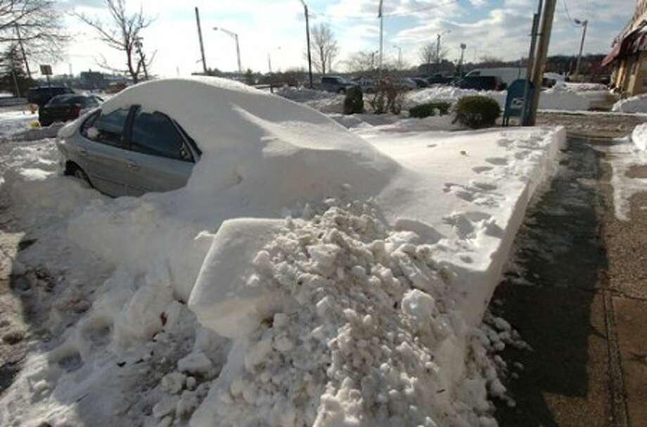Photo/Alex von Kleydorff. A snowed in car in Liberty square in Norwalk on Wednesday.