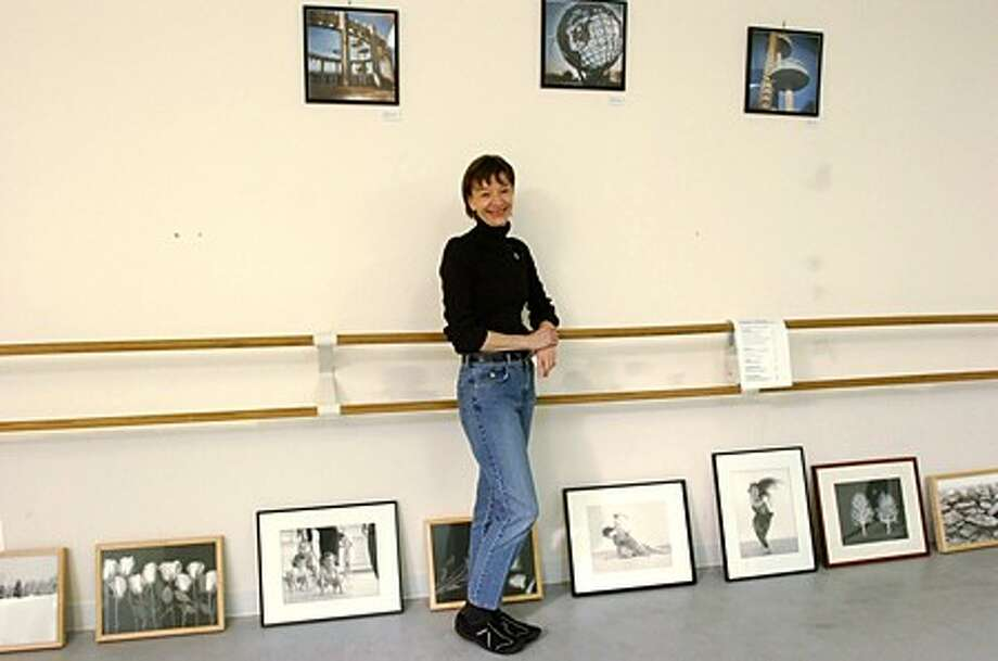 Nancy Schwartz, owner of Performance Dance studio lends her space to artists including photographers John Martin and Kristen Macauley for a benefit art show , Viva Chile!. to raise money for the Red Creoss efforts in the earthquake ravaged South American Country. Hour photo / Erik Trautmann