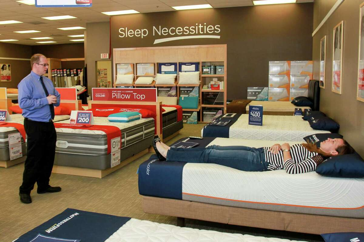 Mattress Firm is among those retailers who raised salaries to comply with a new rule on overtime, and will stick with them. (For the Chronicle/Gary Fountain, May 20, 2016)