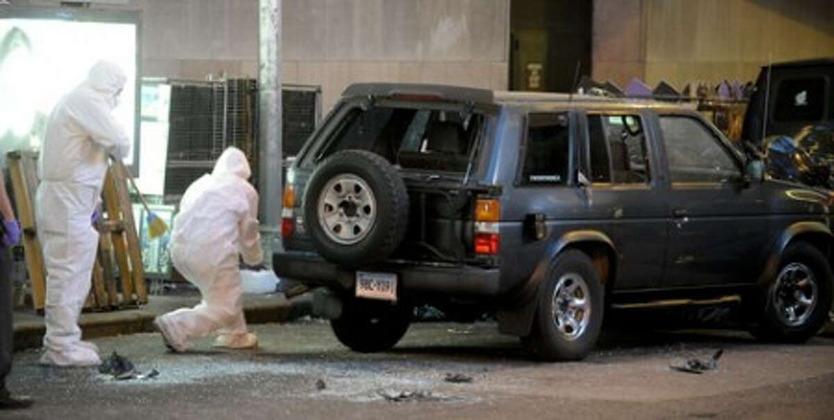 Police investigate a vehicle in New York''s Times Square Sunday morning, May, 2, 2010, after an