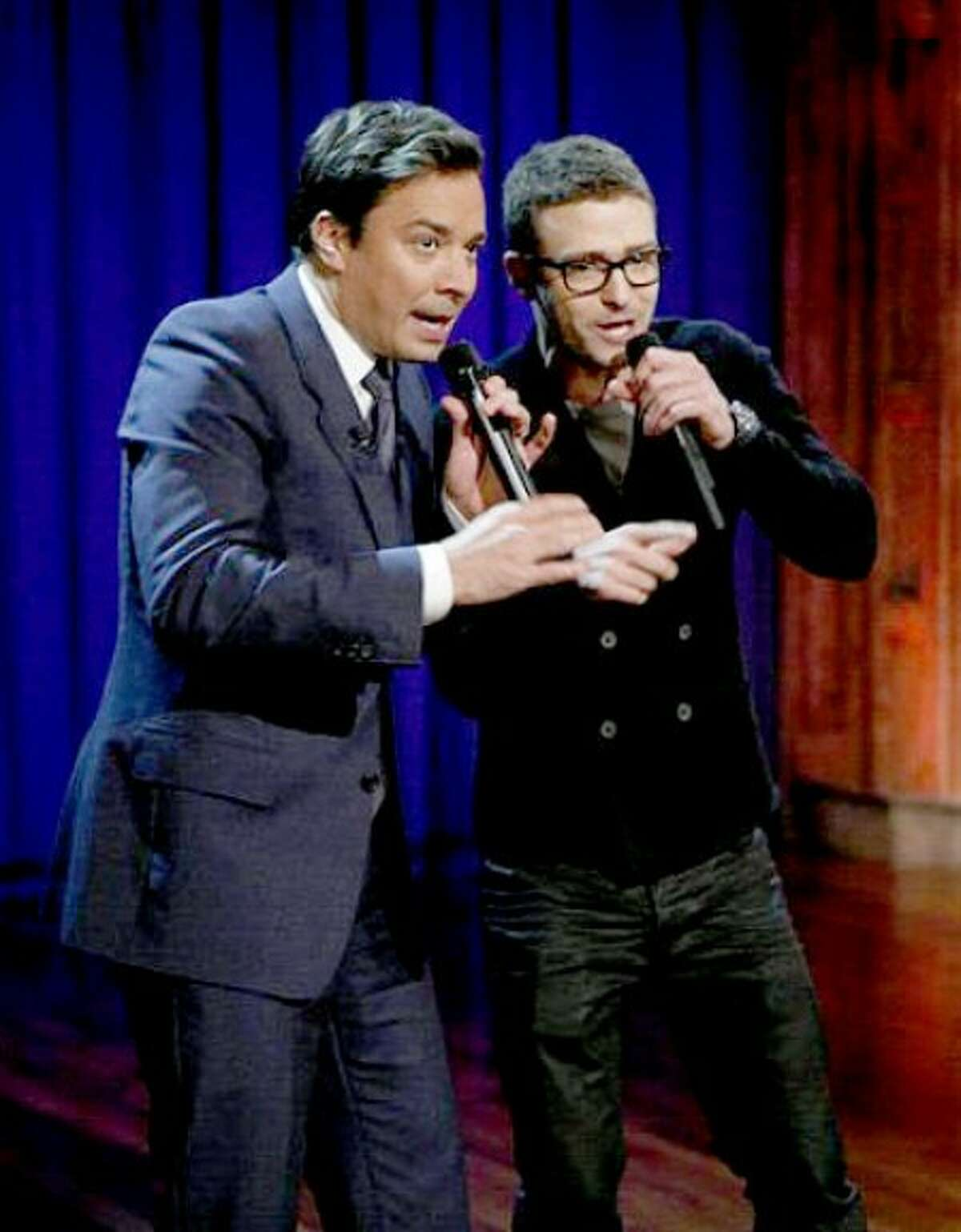 In this publicity image released by NBC, host Jimmy Fallon, left, performs with singer Justin Timberlake during