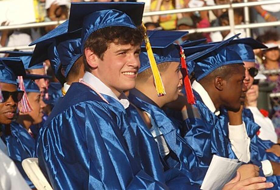Brien Mcmahon High School class of 2010 president Nicholas Cafero listens to the keynote speaker during the commencement exercises Tuesday evening. Hour photo / Erik Trautmann