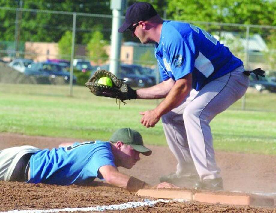 Rec softball at Calf Pasture Beach Monday, play at first base. Kieth Mercer with Mercer Builders sliding safe is Tim Ziegen for Smitty''s. hour photo/matthew vinci