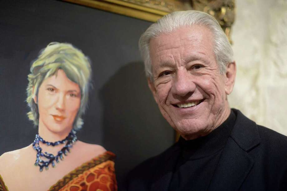 Lionel Sosa, a businessman and advertising consultant, stands in front of a painting of his wife, Kathy, in 2015. He is newly appointed as one of three chairmen of the Alamo Citizen Advisory Committee. Photo: Billy Calzada /Staff Photographer / © 2015 San Antonio Express-News