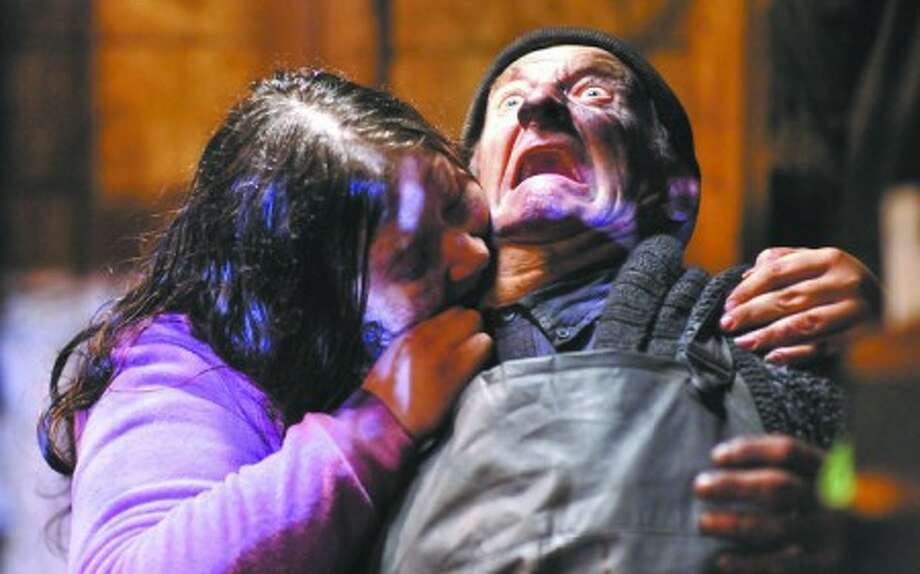 """In this film publicity image released by Magnet Releasing, Wayne Robson, right, is shown in a scene from, """"Survival of the Dead."""" (AP Photo/Magnet Releasing)"""