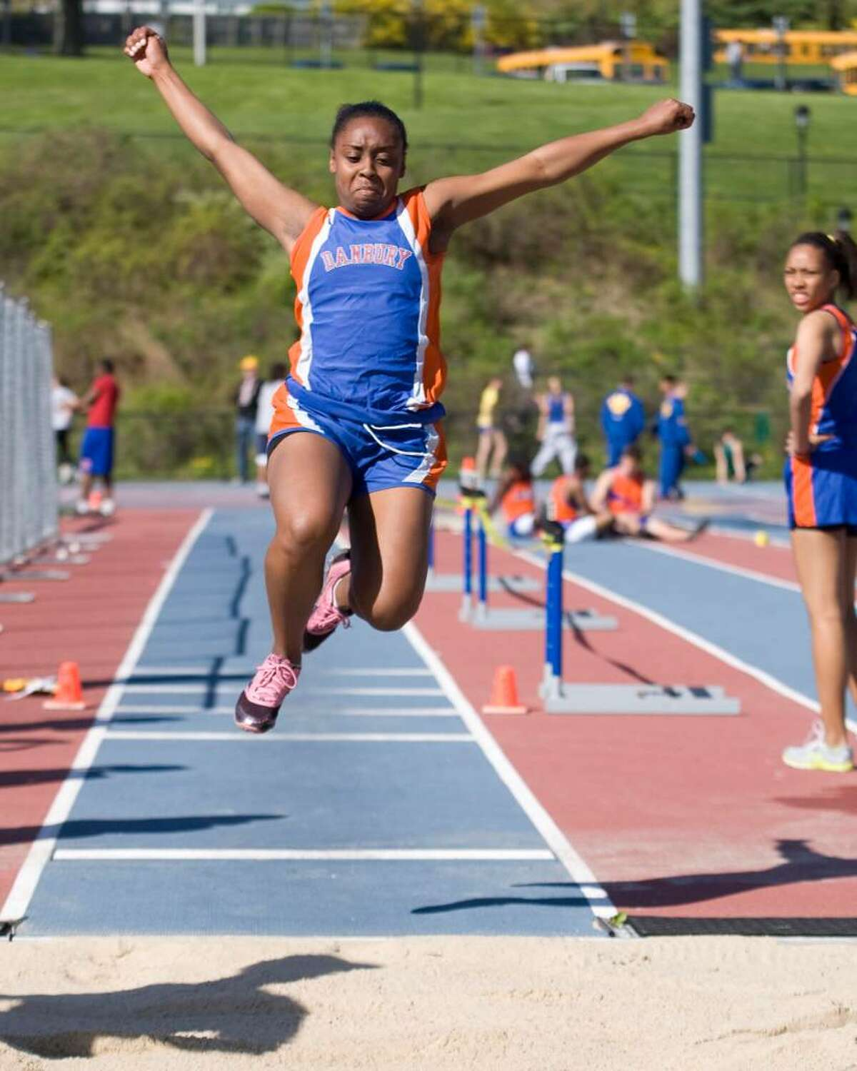 Danbury's Destiny Smith triple jumps during competition at the O'Grady Relays Saturday at Danbury High.