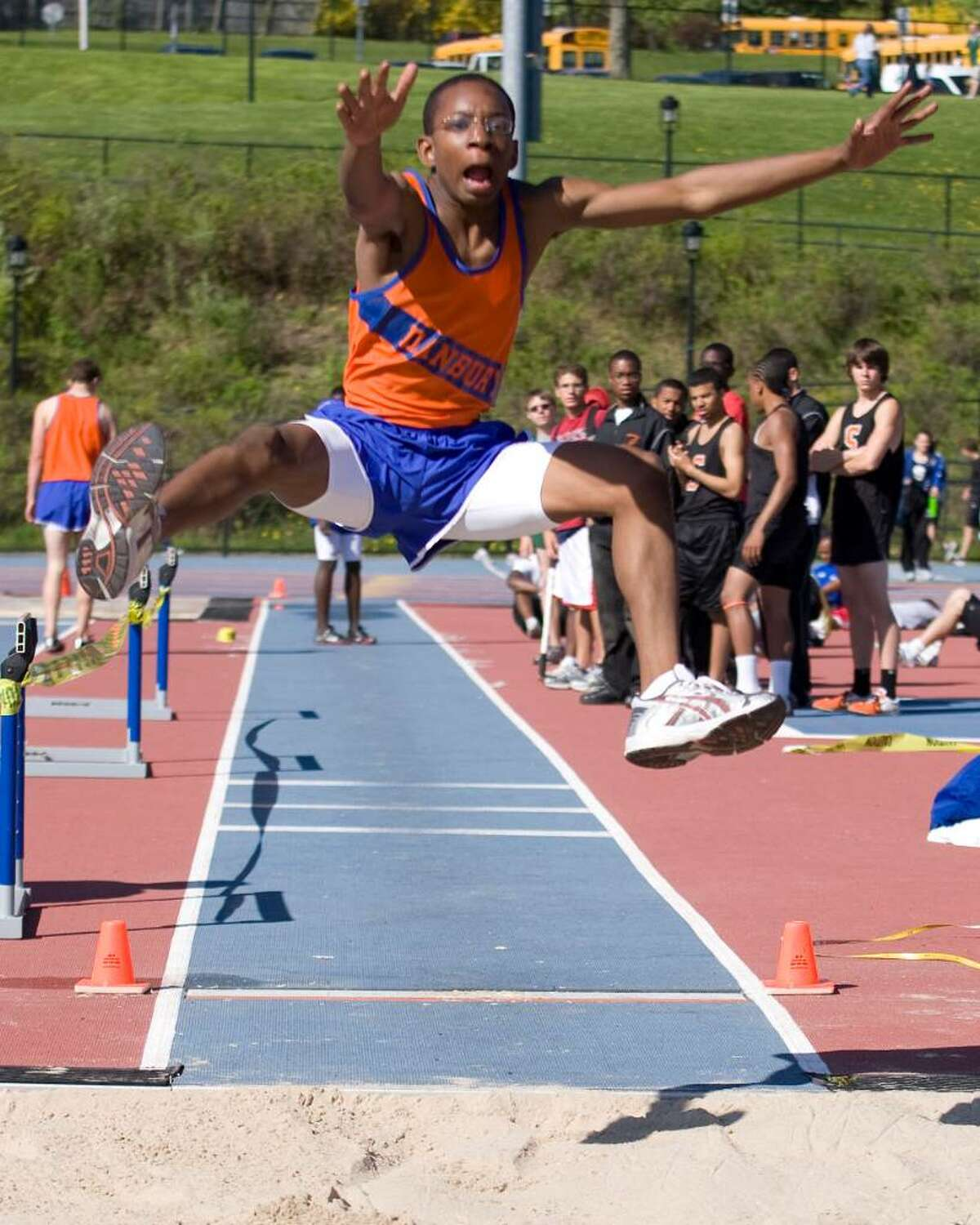 Danbury's Xavier Jones long jumps during competition in the O'Grady Relays Saturday at Danbury High.