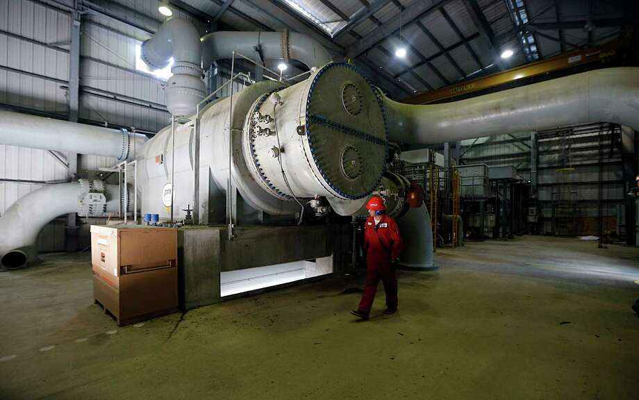 Operator Jaime Valdez looks over a 40 Megawatt Steam Turbine Power Generator during a tour of the Ascend Performance Materials Chocolate Bayou Plant Tuesday, May 10, 2016, in Alvin. Photo: James Nielsen, Houston Chronicle / © 2016  Houston Chronicle