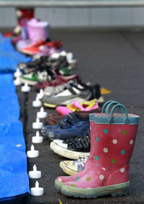 Children's shoes are lined up at a 2012 demonstration, where names of the school shooting victims were read. Photo: Paul Chinn, The Chronicle