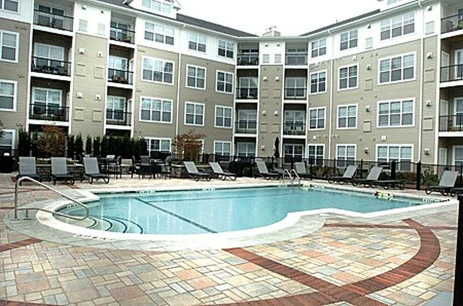 The pool area courtyard at AvalonBay at Cross Street and Belden. hour photo/matthew vinci