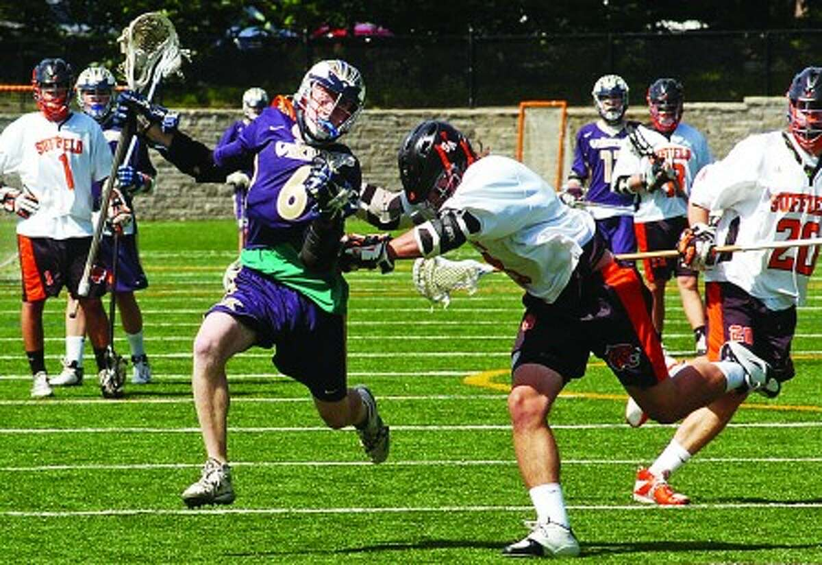 King boys lacrosse player Andrew Howard-Johnson (6) tries to get around a Suffield defender during Saturday''s game at King. Times photo/Erik Trautmann