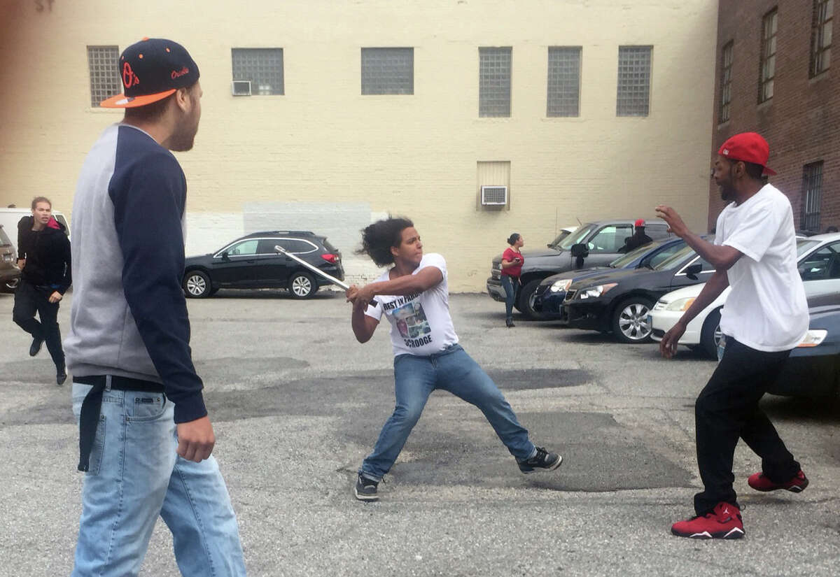People beat each other with bats and torque wrenches while other stomped on cars following a controversial slaying sentencing outside the Main Street courthouse Friday, June 17, 2016.