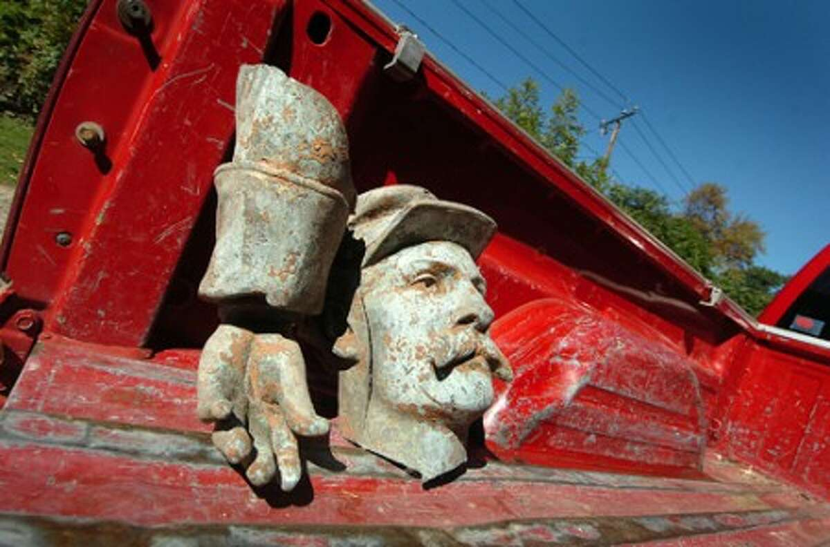 Photo/Alex von Kleydorff. The head and part of an arm sit and wait for the rest of the Civil War statue to be loaded into a pick up at Riverside Cemetery.