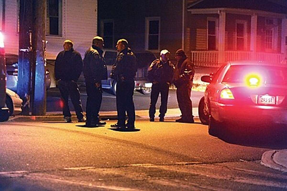 Stamford Police close off the area of Lockwood Avenue where an officer had been shot at around 6:00 Thursday night. hour photo/matthew vinci
