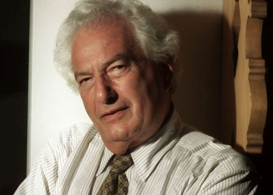 "FILE - In this Sept. 27, 1994 file photo, Joseph Heller the author of the classic anti-war novel ""Catch 22,"" poses in New York. Heller''s million-selling send-up of war and military bureacracy, one of the notable missing links in the digital library, was recently released electronically by Simon & Schuster and a 50th anniversary edition in hardcover and paperback next year. (AP Photo/Jim Cooper, file)"