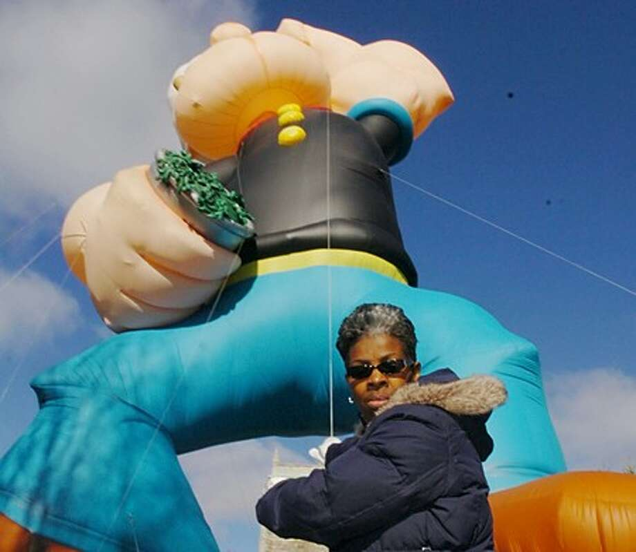 Norwalk resident and United Way employee, Gale Houser, participates in the balloon handler training by Fabulous Balloons in preparation for the annual UBS Parade Spectacular on Nov. 21 in Stamford. Hour photo / Erikk Trautmann