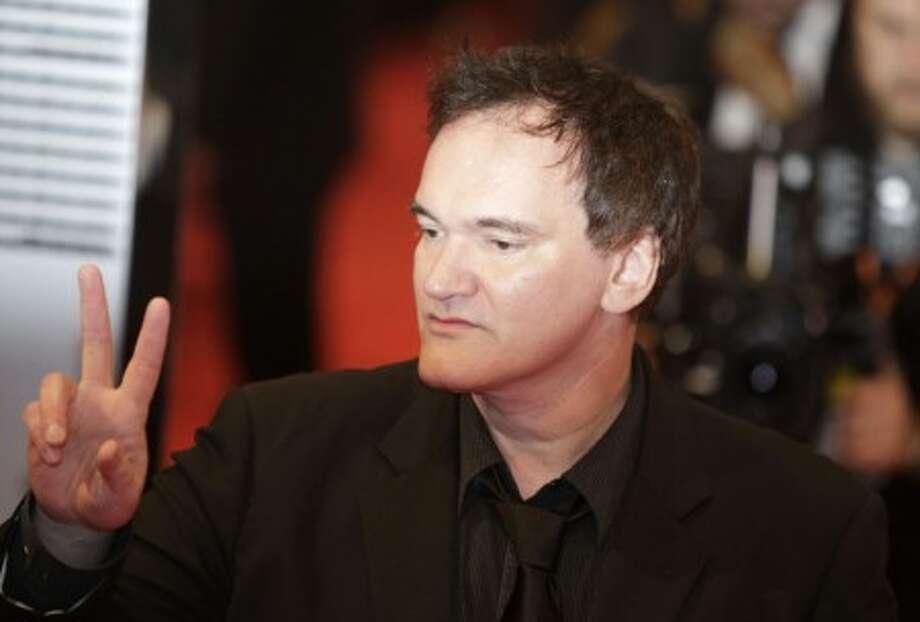US director Quentin Tarantino gestures on arrival at the British Academy Film Awards 2010 at The Royal Opera House in London, Sunday, Feb. 21, 2010. (AP Photo/Lefteris Pitarakis)