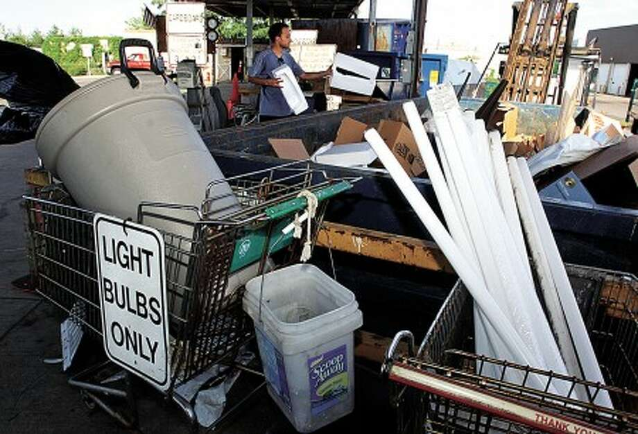 "Stamford residents dispose of reclyclables at the Katrina Mygott recycling Center on Magee Ave Tuesday. The Center instituted the Single Stream program one year ago which touts ""One Bin , All In"". Hour photo / Erik Trautmann"