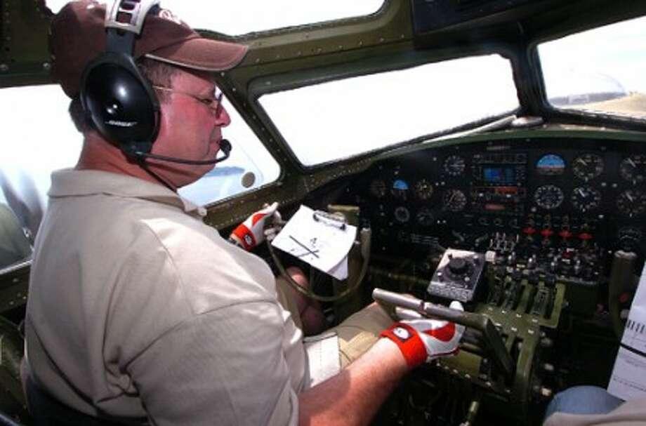 Photo/Alex von Kleydorff. Pilot Bill Hill flys the Liberty Belle B-17 over the cioast of Connecticut.