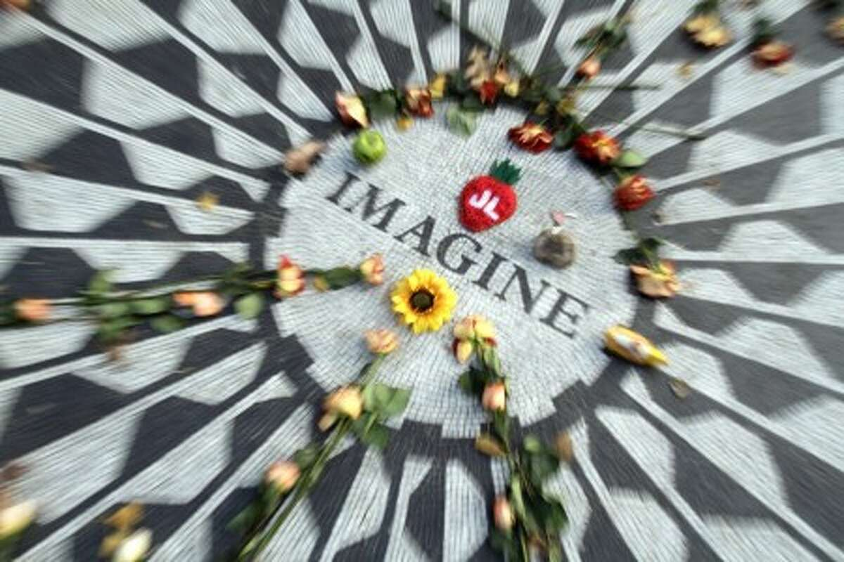 The Imagine mosaic in Strawberry Fields is decorated with flowers and other mementos, Tuesday, Dec. 7, 2010 in New York. Wednesday marks 30 years since John Lennon was murdered outside his New York apartment, triggering a wave of grief around the world. (AP Photo/Mary Altaffer)