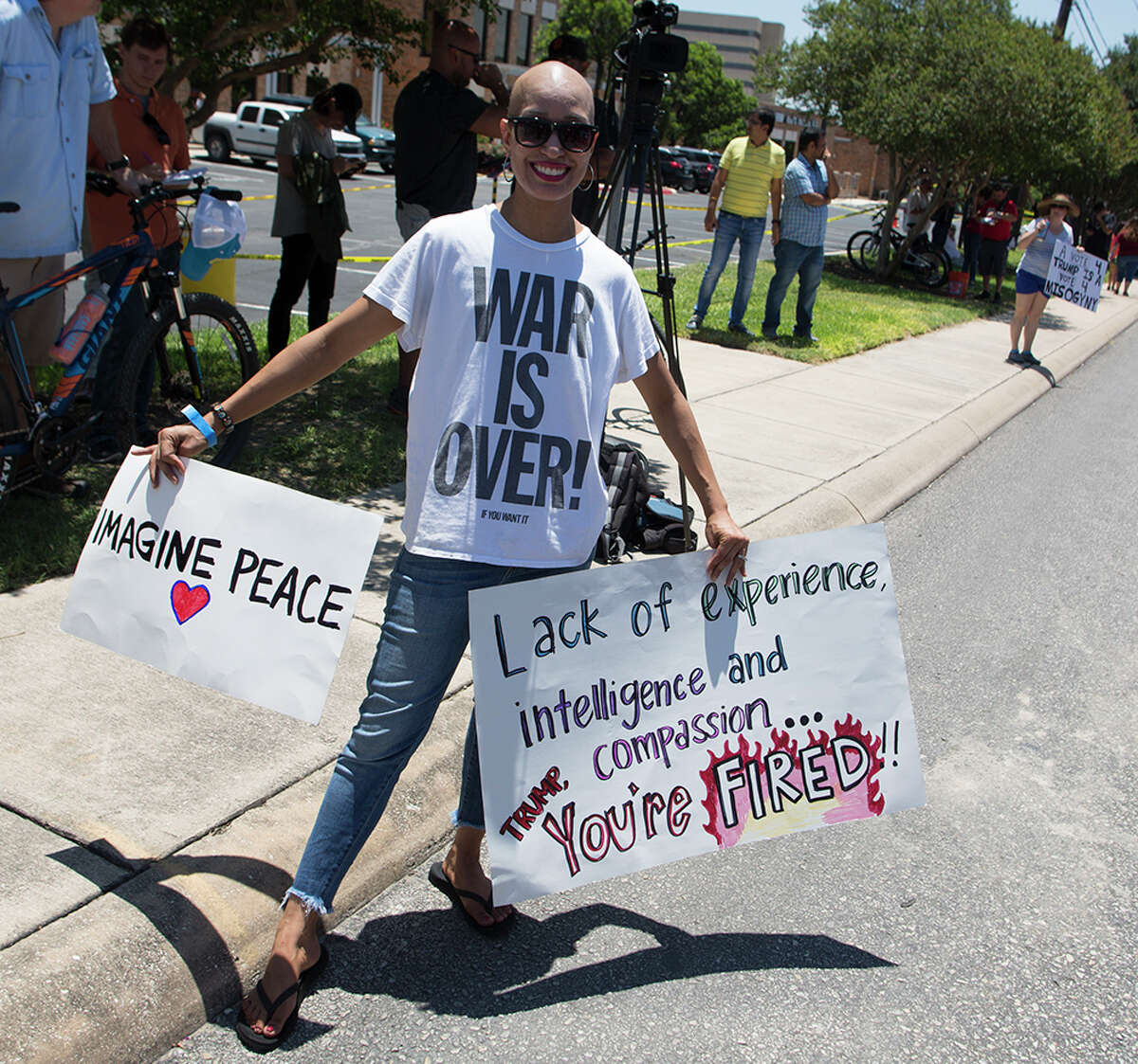 Hundreds of demonstrators assembled for Republican presidential candidate Donald Trump's visit to San Antonio, gathering near his private fundraiser at Oak Hills Country Club on June 17, 2016
