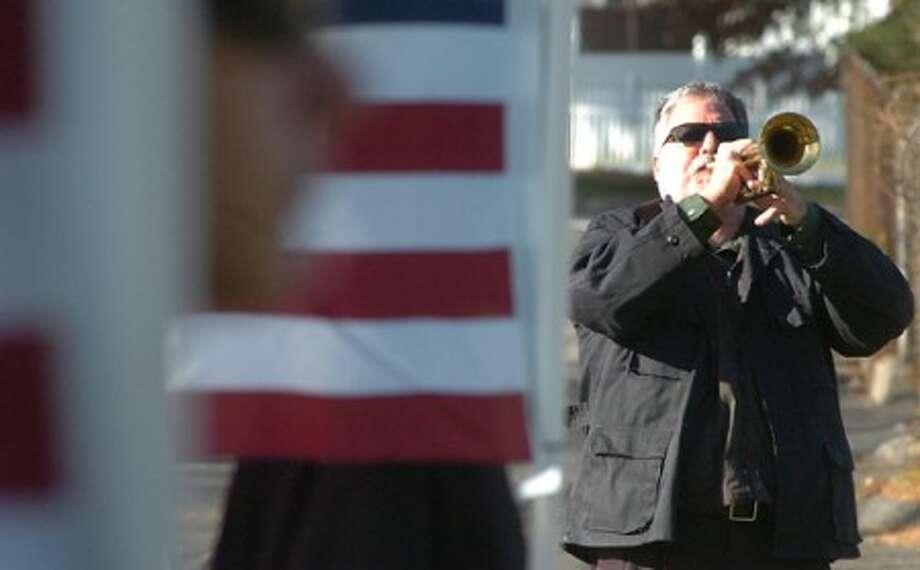 Photo/Alex von Kleydorff American Legion Post 12 Bugler Reed Corbo plays Taps during the post''s Veteran of the Month program on Sunday.