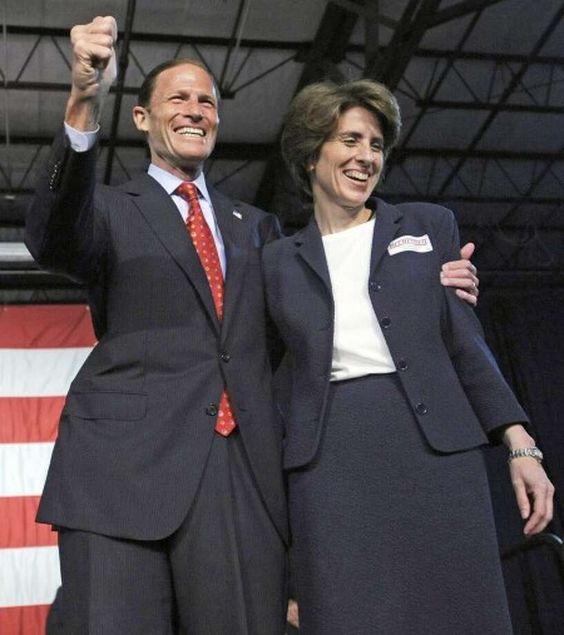 Connecticut state Attoreny General Richard Blumenthal and his wife, Cynthia, greet the crowd at the Democratic State Convention in Hartford, Conn., Friday, May 21, 2010 after he was nominated to run for the U.S. Senate.