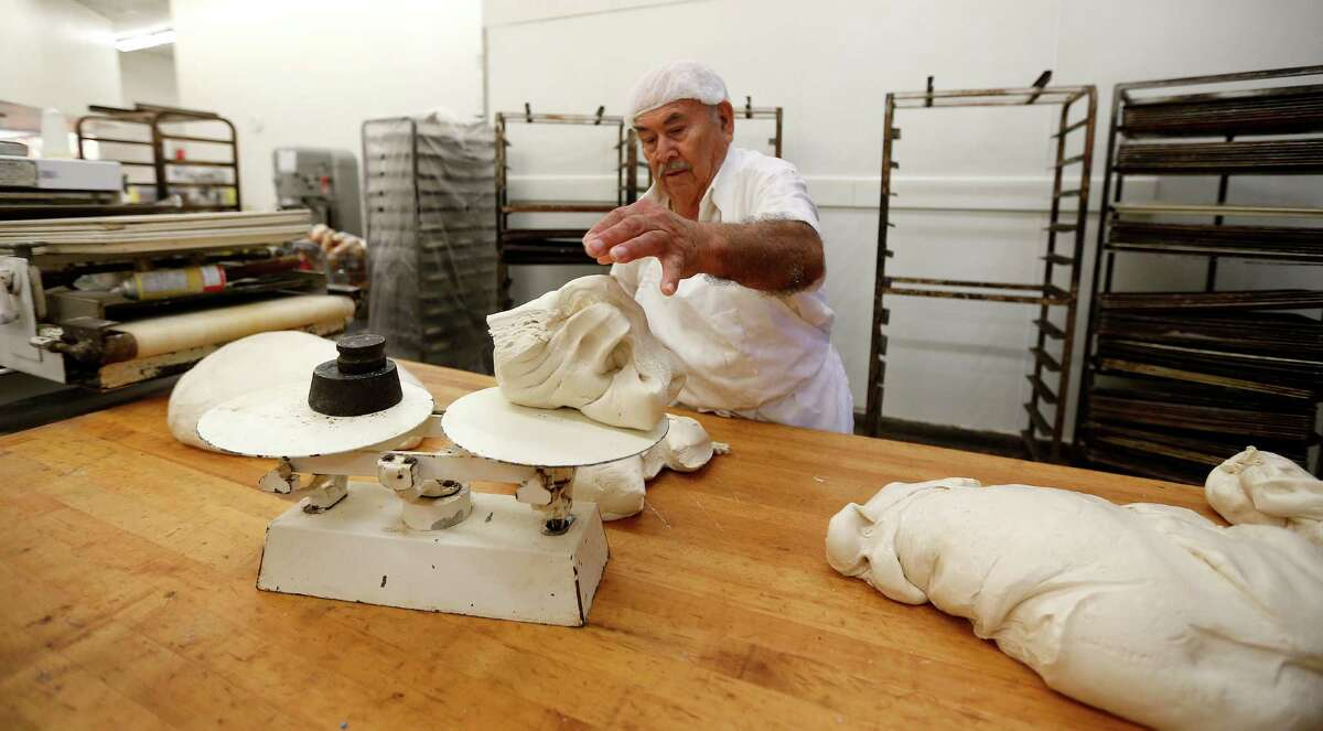Heriberto Gonzalez works dough for baked goods, in the bakery at Fiesta Mart at 8130 Kirby Drive.