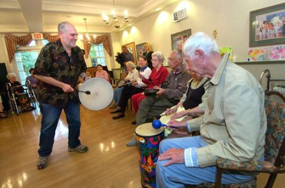 Photo/Alex von Kleydorff. Randy Brody with Sound Directions, gets the Drum Circle in rythym at The Greens at Cannondale.