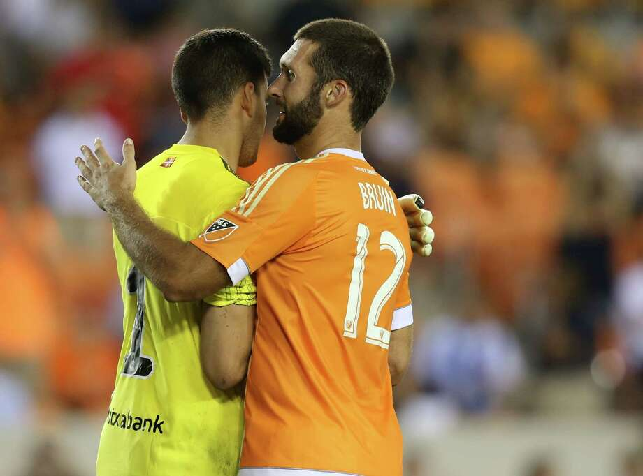 Houston Dynamo defender Will Bruin (12) and Real Sociedad goalkeeper Geronimo Rulli (1) shake hands after Bruin made a penalty kick to end the game  on Tuesday, May 24, 2016, in Houston. Dynamo won on penalty  kicks 5-4. ( Elizabeth Conley / Houston Chronicle ) Photo: Elizabeth Conley, Staff / © 2016 Houston Chronicle