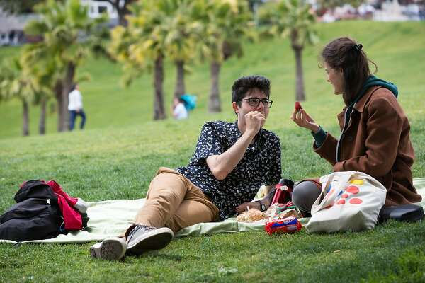 David Jones and Mary Smith eat strawberries while enjoying an afternoon picnic in Dolores Park on Friday, June 17, 2016.