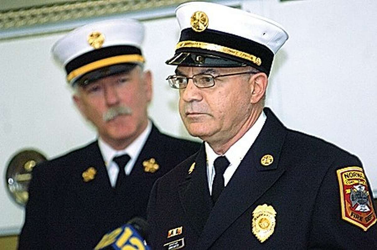 Captain Gino Gatto is promoted to the rank of Deputy Chief of Training on Monday at the Norwalk Fire headquarters. hour photo/matthew vinci