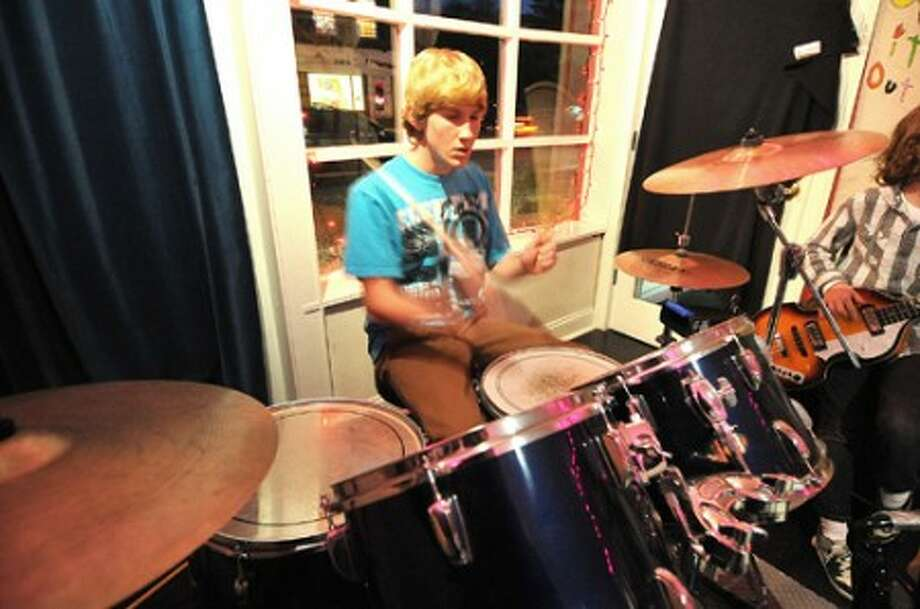 Photo/Alex von Kleydorff. 14 yr old Ben Kubie from Rowayton plays with the band in a rehearsal room at School of Rock in Fairfield.