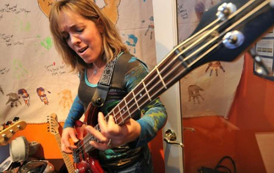 Photo/Alex von Kleydorff. Westports Trish Boyle plays Long Cool Woman by The Hollies during her bass lesson at School of Rock.