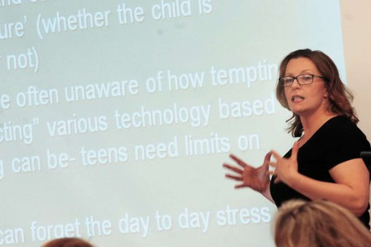 Liz Driscoll Jorgensen, owner of Insight Counciling Center in Ridgefield speaks to teens at Cider Mill school on Wednesday about substance abuse. photo/matthew vinci