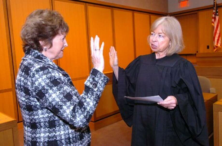 Photo/Alex von Kleydorff. Stamfords Julie Cohen is sworn in as a Child Advocate by Judge Mary Sommer at Stamford Juvenile Court.