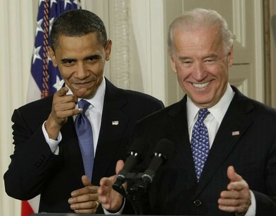 President Barack Obama and Vice President Joe Biden react to cheers as they arrive in the East Room of the White House in Washington,Tuesday, March 23, 2010, for the signing ceremony for the health care bill. (AP Photo/J. Scott Applewhite)