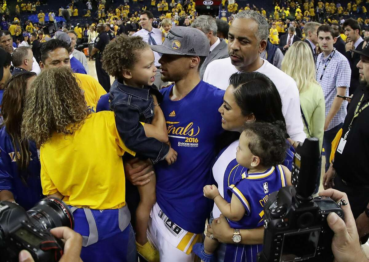 OAKLAND, CA - MAY 30: Stephen Curry #30 of the Golden State Warriors celebrates with his wife Ayesha Curry and girls Riley and Ryan and father Dell Curry after they beat the Oklahoma City Thunder in Game Seven of the Western Conference Finals during the 2016 NBA Playoffs at ORACLE Arena on May 30, 2016 in Oakland, California. NOTE TO USER: User expressly acknowledges and agrees that, by downloading and or using this photograph, User is consenting to the terms and conditions of the Getty Images License Agreement. (Photo by Ezra Shaw/Getty Images)