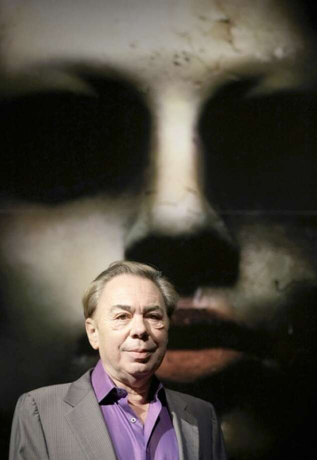 """British composer Andrew Lloyd Webber promotes his new production """"Love Never Dies"""" at a theater in London. (AP Photo/Matt Dunham, file)"""
