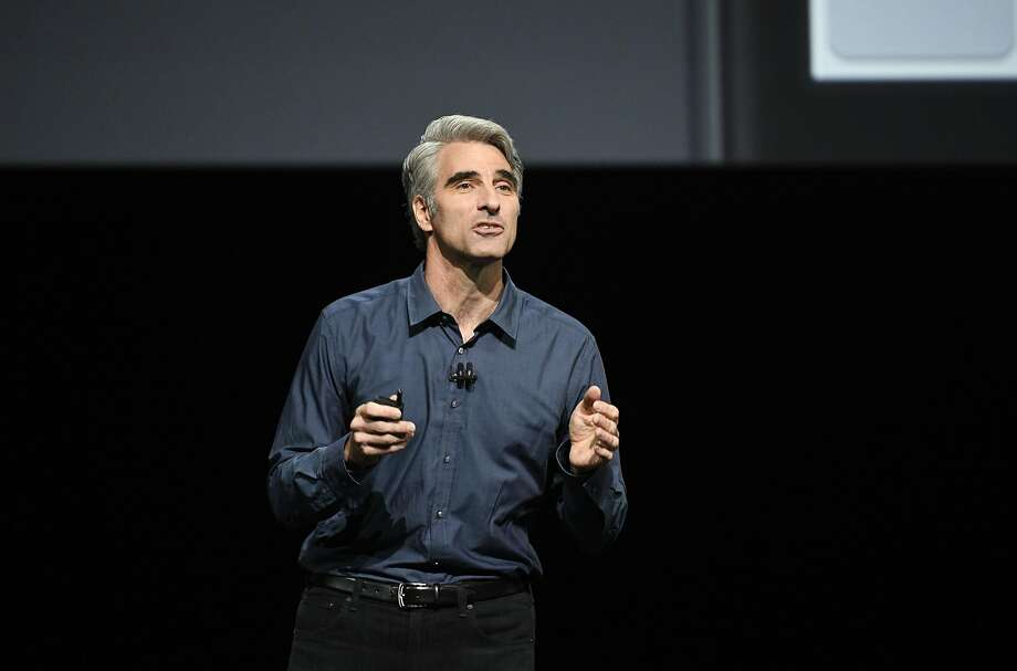 Craig Federighi, senior vice president of Software Engineering at Apple Inc., speaks during the Apple World Wide Developers Conference (WWDC) in San Francisco, California, U.S., on Monday, June 13, 2016. Apple Inc.'s mobile-payment service Apple Pay will now work on websites, a long-awaited feature that will pit the company directly against companies such as PayPal Holdings Inc. Photographer: David Paul Morris/Bloomberg Photo: David Paul Morris, Bloomberg