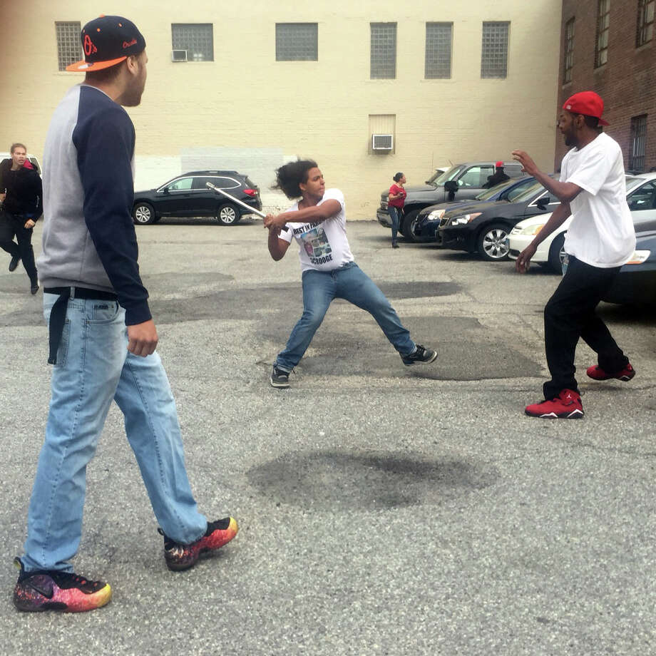 Unidentified men fight in a parking lot near the Fairfield County Courthouse, in Bridgeport, Conn. June 17, 2016. Photo: Contributed Photo / Contributed Photo / Connecticut Post Contributed