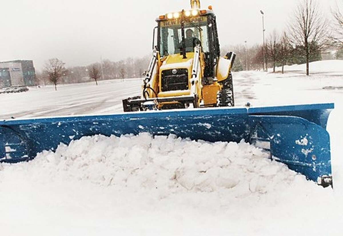 Plows clear out Norden place in Norwalk on Wednesday. hour photo/matthew vinci