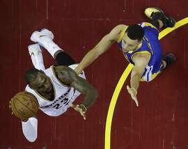 Cleveland Cavaliers forward LeBron James (23) against Golden State Warriors guard Stephen Curry (30) in the first half in Game 6 of the NBA basketball Finals, Thursday, June 16, 2016, in Cleveland. (AP Photo/Ron Schwane)