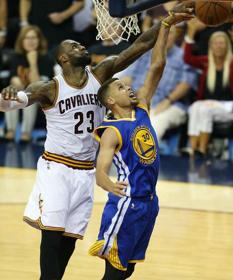 Cleveland Cavaliers forward LeBron James (23) blocks a shot by Golden State Warriors guard Stephen Curry (30) during the second half of Game 6 of basketball's NBA Finals in Cleveland, Thursday, June 16, 2016. (AP Photo/Ron Schwane) Photo: Ron Schwane, Associated Press