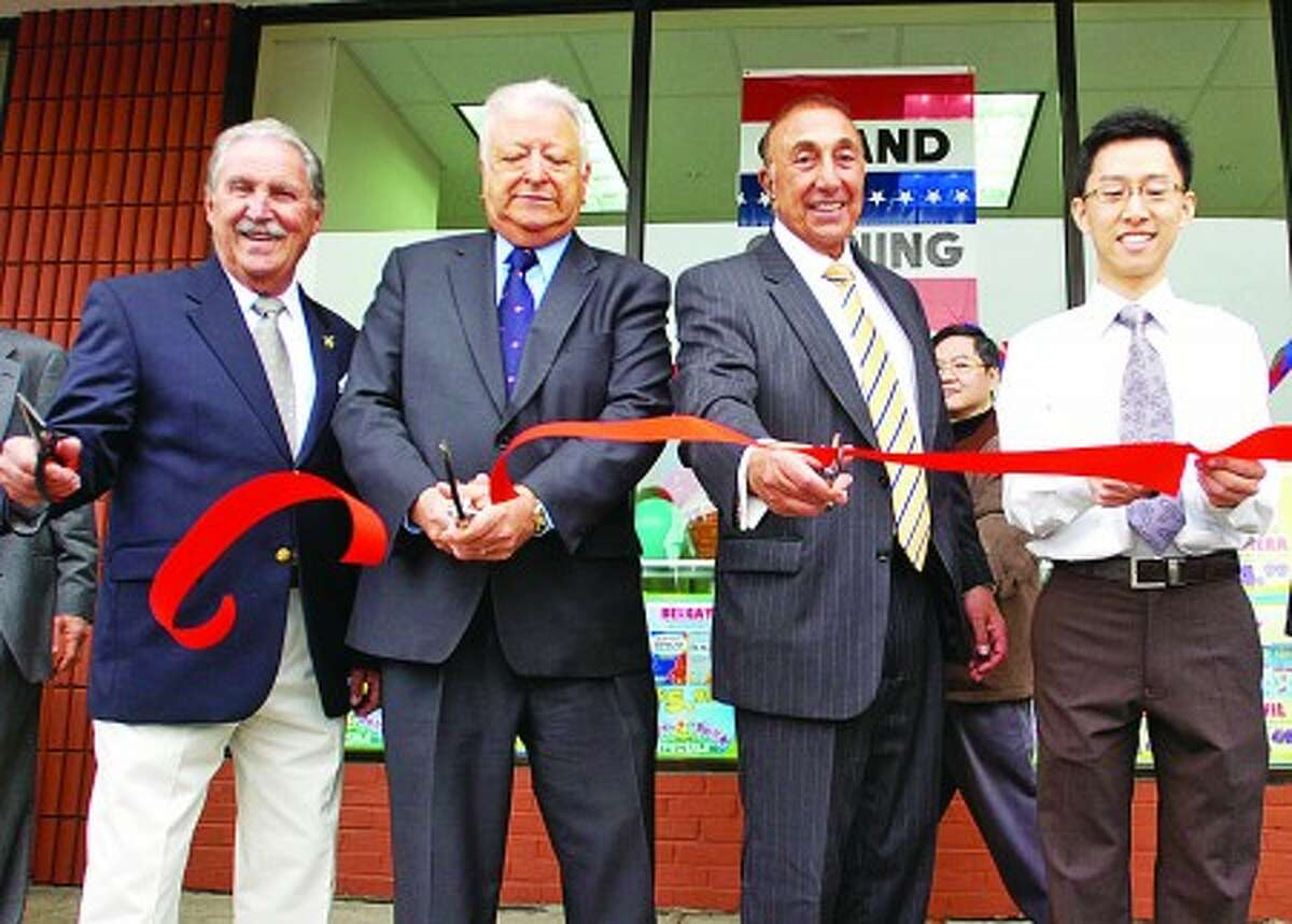 Joe Breault Sr. , Executive Vice President of MF DiScala & Company, Inc., Mayor Richard Moccia, Mike Discala, President of MF DiScala & Company, Inc. and Norwalk Pharmacy owner Kenneth Lee cut the ribbon during the Grand Opening ceremony of the new store on Westport Ave. Hour photo / Erik Trautmann