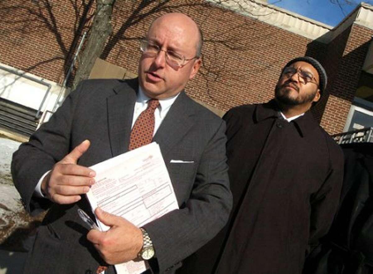 Photo Alex von Kleydorff. Attorney Philip Russell leaves Norwalk Superior Court on Monday, with his client Reverend Phillip Joubert after his arraignment.